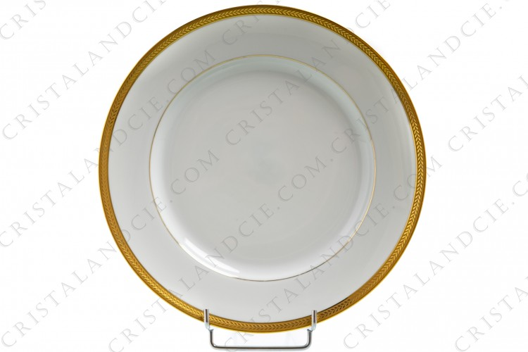 Dinner plate in Limoges china by Lafarge decorated with a frieze of laurels in gold inlays