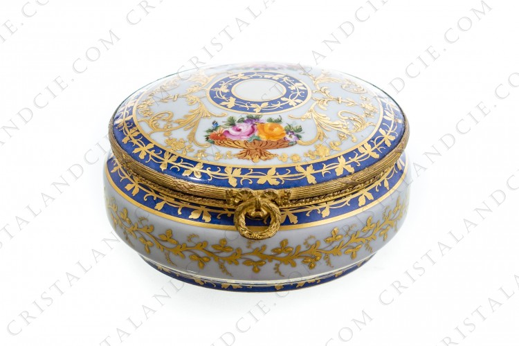 Round box in china hand decorated by the workshops Le Tallec at Paris, decorated with polychromes bouquets of flowers, gold enameled arabesques and gold friezes of leaves on a blue background photo-1