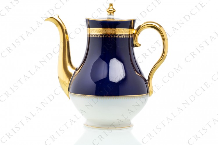Coffee pot in china of Limoges by Theodore Haviland decorated with a gold inlays arabesques frieze on a cobalt blue background photo-1