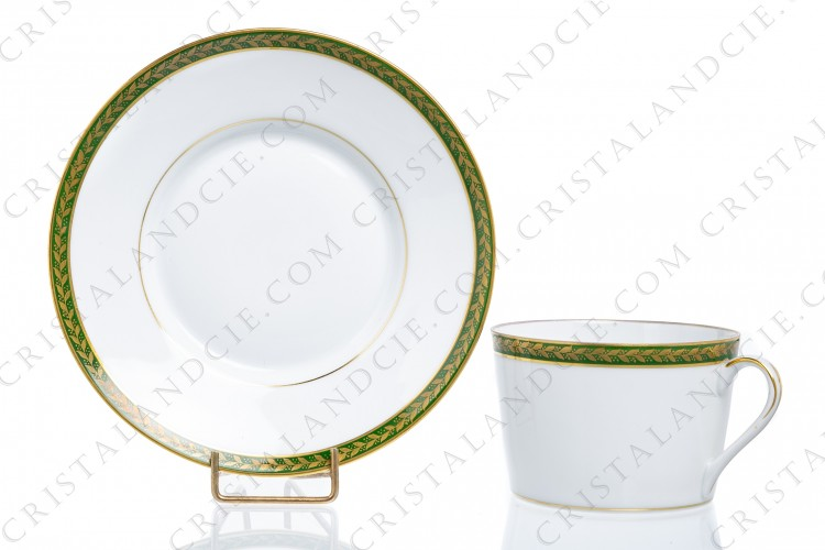 Breakfast cup in Limoges china decorated with a frieze of gold laurels on a green background, hand painted by the workshops Leclair