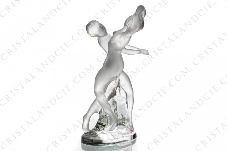 Figurine in crystal by Lalique pattern Deux Danseuses representing two nude and frosted women dancing around a roc in clear crystal