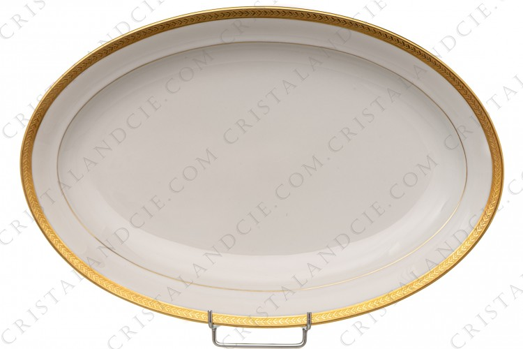 Big oval dish in china of Limoges by Chastanier decorated with a frieze of laurels in gold inlays photo-1