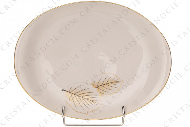 Oval platter in Limoges china by Bernardaud pattern Catherine created by Nicole Desjardin, decorated with gold and black leaves