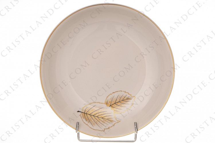 Deep round dish in Limoges china by Bernardaud pattern Catherine created by Nicole Desjardin, decorated with gold and black leaves