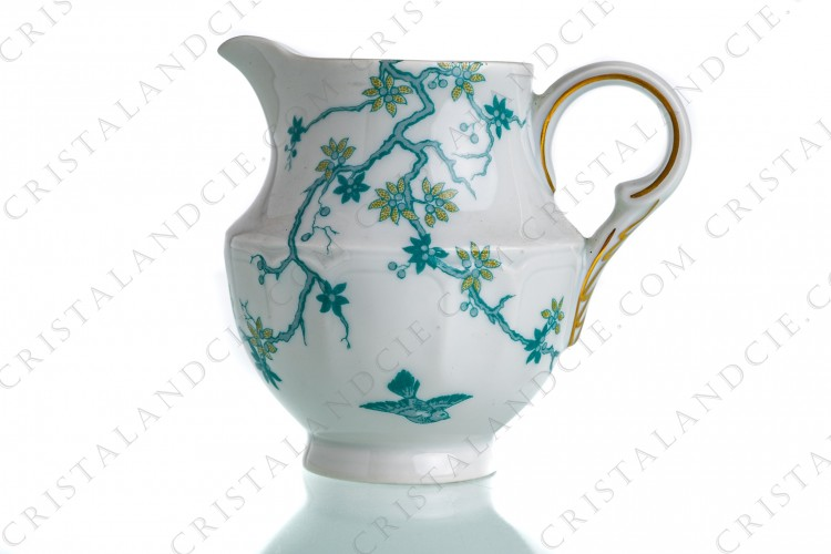 Creamer in Limoges china by Haviland and Parlon with a blue shades pattern of flowered branches and bird