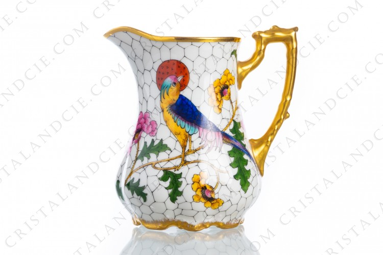 Creamer in Limoges china decorated with hand painted bird of paradise on flowery branches by the workshop P