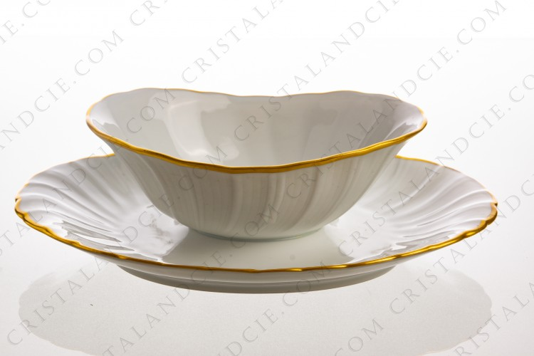 Gravy boat in Limoges china by Bernardaud pattern Verlaine decorated with palmettes and a gold border