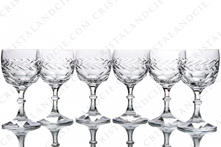 Set of six water glasses n°2 in crystal by Lalique pattern Beauharnais decorated with flat cuts on the bottom of the gob and on the foot, frieze of leaves on the gob