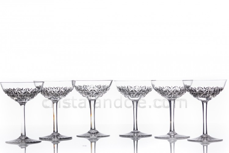 Set of six Champagne saucers in crystal by Baccarat pattern Bellinzona with an important cur pattern on the parison and the foot