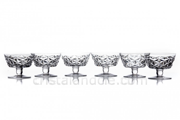 Set of six Champagne saucers in crystal by Baccarat pattern Muret with an important cut pattern
