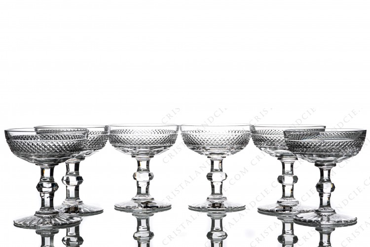 Set of six Champagne saucers in crystal by Saint-Louis pattern Trianon with the gob is decorated with a Diamond tips frieze, stem with a ring
