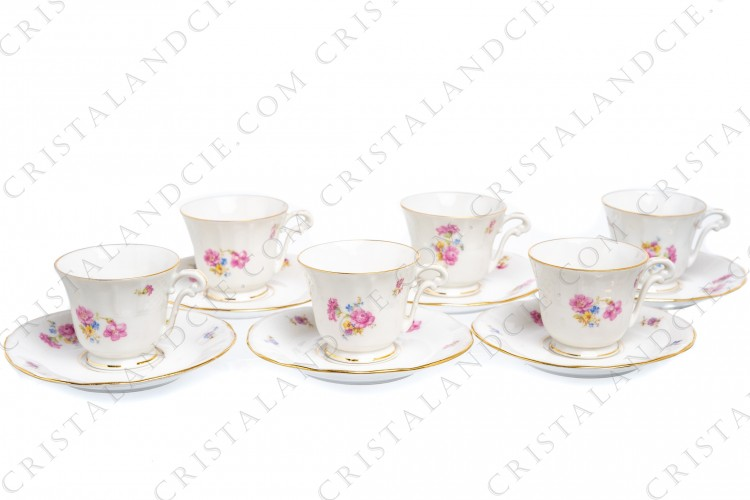 Set of six coffee cups in china of Limoges by Bernardaud decorated with polychromes flowers and gold borders