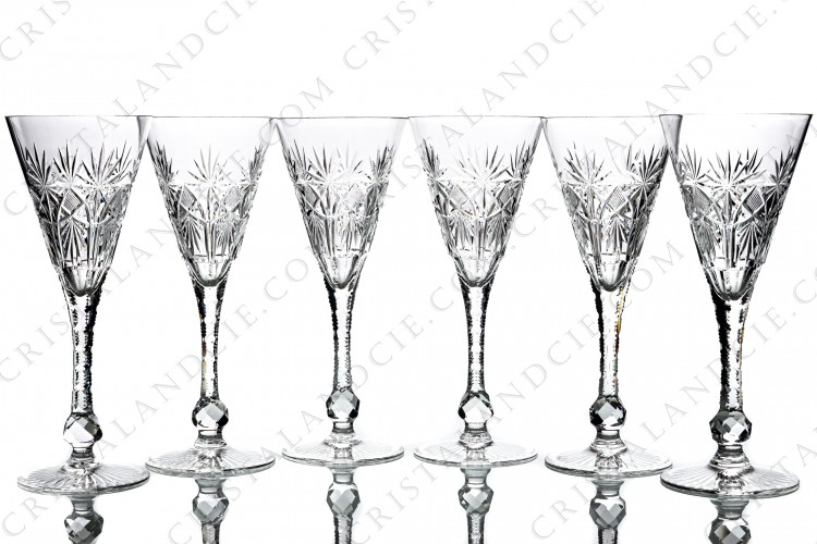 Set of six Champagne glasses in crystal by Saint-Louis pattern Cosmos cut 7113 with an important cut patten on the gob, an engraved stem with a faceted ring and a star under the foot