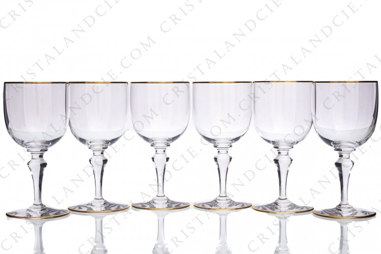 Set of six water glasses n°2 in crystal by Baccarat pattern Mahora decorated with gold borders