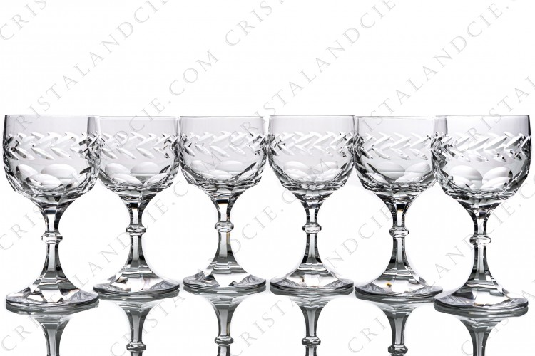 Set of six wine glasses n°4 in crystal by Lalique pattern Beauharnais decorated with flat cuts on the bottom of the gob and on the foot, frieze of leaves on the gob