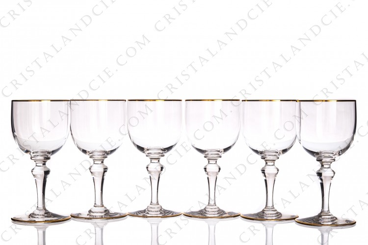 Set of six wine glasses n°3 in crystal by Baccarat pattern Mahora decorated with gold borders