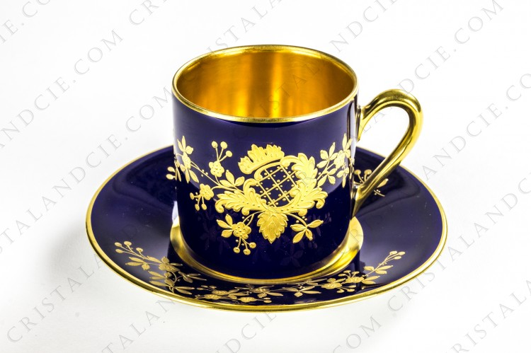Coffee cup in Limoges china hand decorated by Carmona with gold flowered boughes on a cobalt blue background