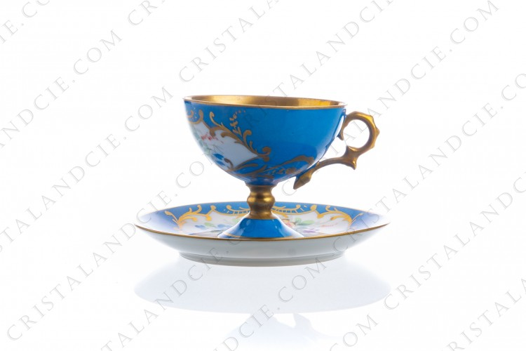 Coffee cup on foot in Limoges china, hand painted with polychromes flowers on a blue and gold background