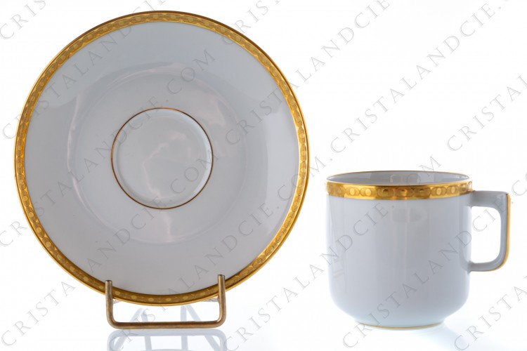 Coffee cup in Limoges china by Bernardaud pattern Clio,decorated with inlays of two layers of browned with agate matt gold
