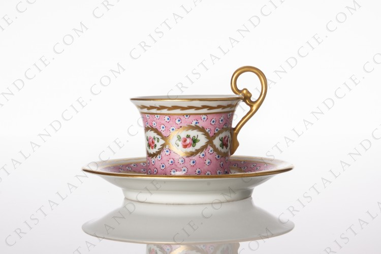 Coffee cup in Sevres china with a hand painted pattern of roses on a pink background gold enhanced photo-1