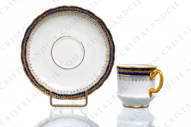 Coffee cup in Limoges china by Theodore Haviland decorated with hand painted cobalt blue and gold
