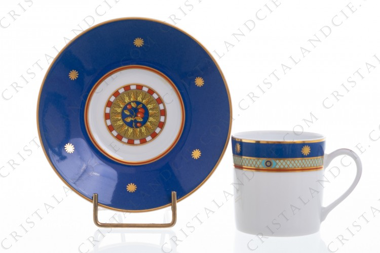 Coffee cup in china of Limoges by Bernardaud pattern Solaris decorated with blue, green and red friezes and with gold borders and suns