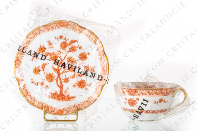 Tea cup in Limoges china by Haviland pattern Arbre corail shape Lutece decorated with a coral flowered tree in the middle, with vegetables friezes and with a gold border