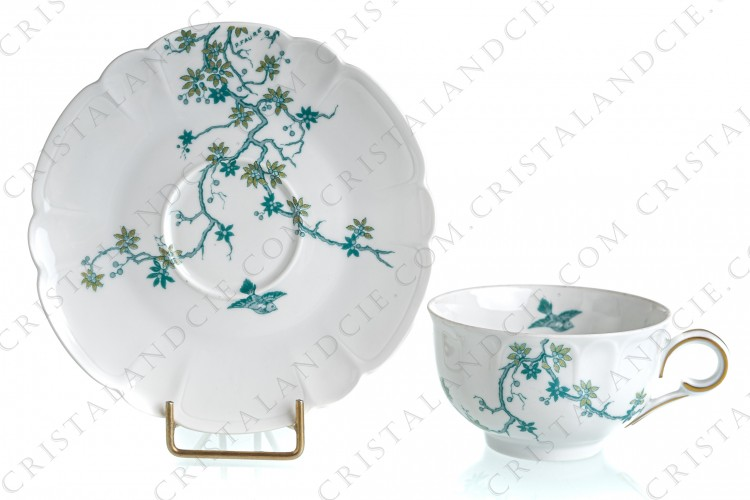 Tea cup in Limoges china by Haviland and Parlon with a blue shades pattern of flowered branches and bird