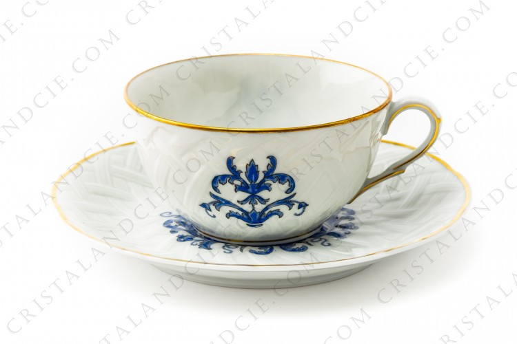 Tea cup in Limoges china by Bernardaud pattern Louis XIII decorated with basketry and blue vegetables arabesques