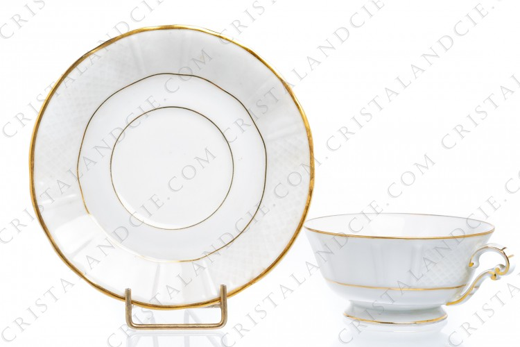 Tea cup in Limoges china by Bernardaud decorated with grid pattern and gold strips