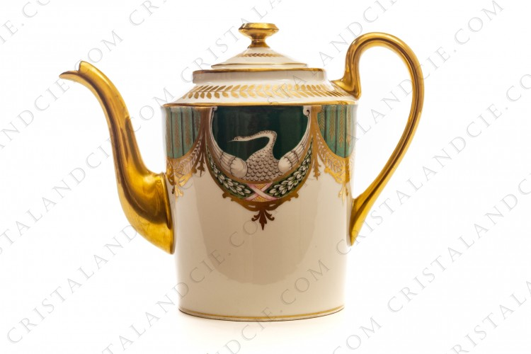 Tea pot in china of Limoges by Charles Ahrenfeldt hand painted with swans on a green background, and green and gold garlands and friezes