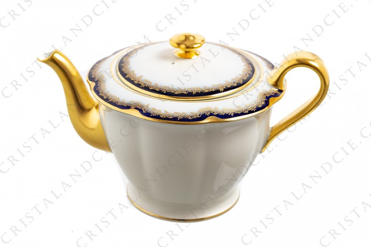 Tea pot in china of Limoges by Theodore Haviland decorated with cobalt blue and gold stripes and with a gold frieze of ribbons and leaves
