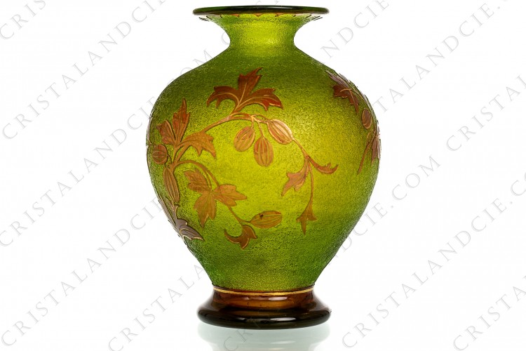 Art Nouveau vase in green and red double layer crystal by Saint-Louis with a red gold enhanced vegetal pattern on a green engraved with acid background