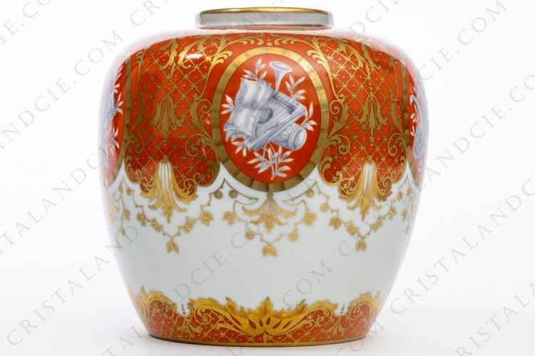 Vase in china of Paris hand decorated by the workshop Le Tallec, decorated with the grey enameled attributes of music and gold arabesques on an orange and white background photo-1