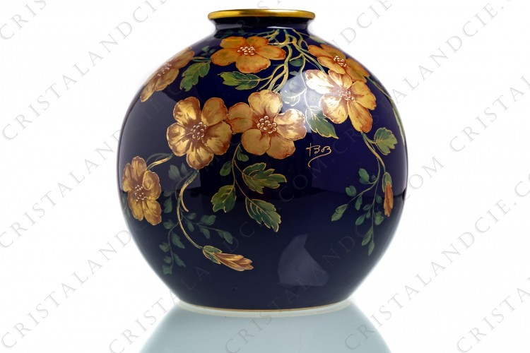 Ball vase in china of Limoges by Pastaud with a hand painted pattern of gold flowers and green gold enhanced leaves on a cobalt blue background photo-1
