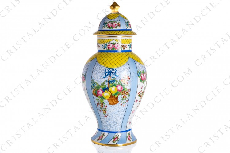 Covered vase in china of Paris with an hand painted and hand enameled pattern of polychromes bouquets of flowers on a blue and white background, with a flowered grid on a yellow background and with gold lines
