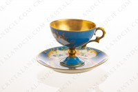Coffee cup on foot in Limoges china, hand painted with polychromes flowers on a blue and gold background photo-2