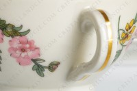 Tea cup in china of Limoges by Theodore Haviland decorated with a Japanese pattern of polychrome flowers photo-7